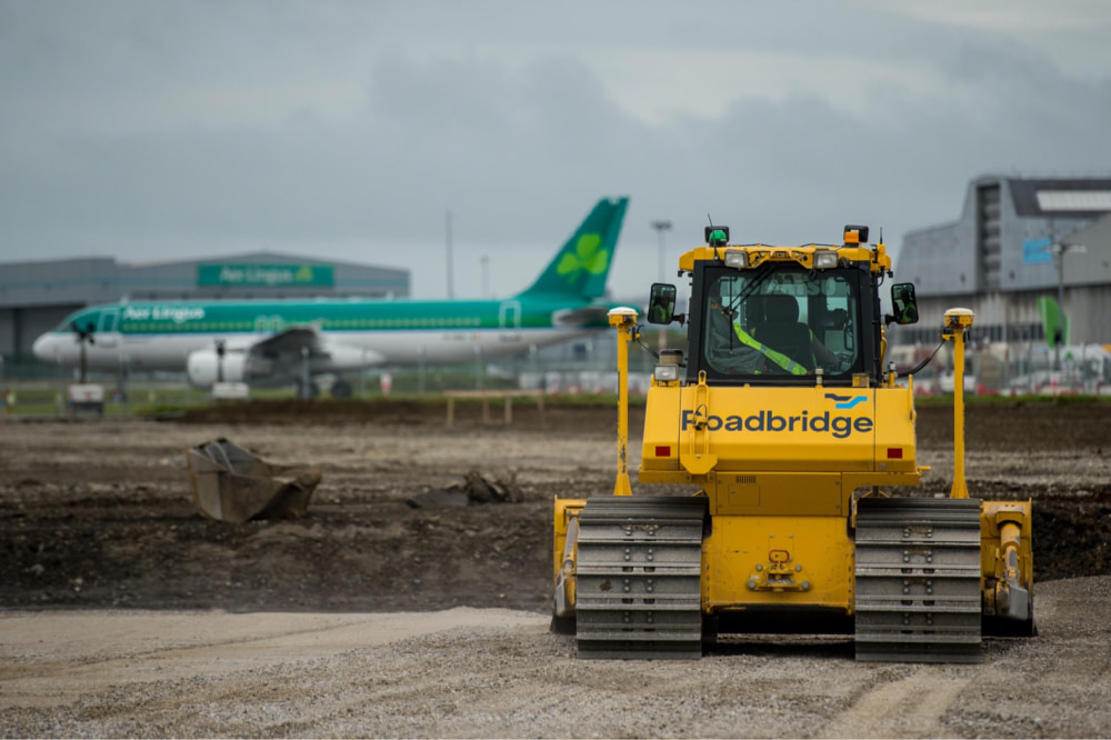 Photograph of a Roadbridge bulldozer in front of an airport jobsite